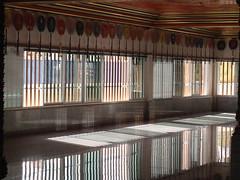 Reflections in Wat Paknam Bhasicharoen Temple, Bangkok, Thailand