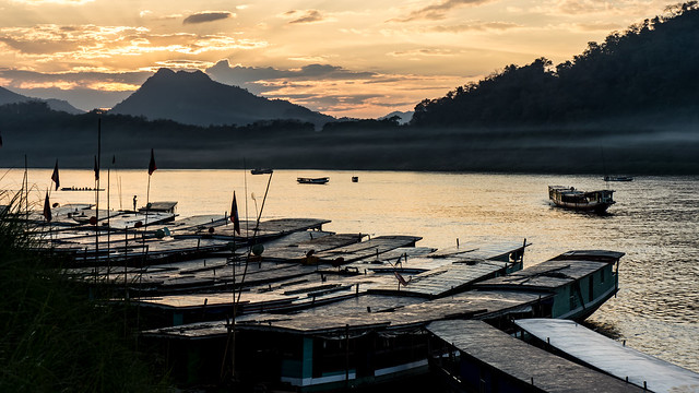 view over boats in the Mekong on sunset