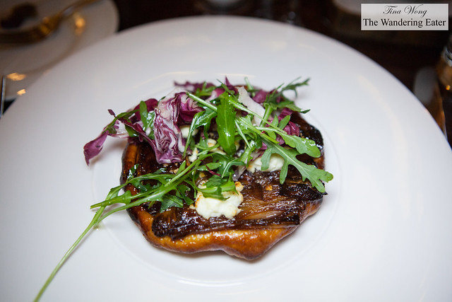 Shallot confit tarte tatin, Pant-Ysgawn goat cheese, winter leaves