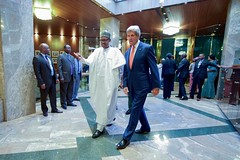 Nigerian President Muhummadu Buhari leads U.S. Secretary of State John Kerry to his private office on August 23, 2016, at the Presidential Villa in Abuja, Nigeria, for a one-on-one discussion following a bilateral meeting, and preceding other discussions by the Secretary with Foreign Minister Geoffrey Onyeama and Governors of the country's Northern region. [State Department Photo/ Public Domain]
