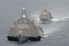 In this file photo, USS Independence (LCS 2), foreground, and USS Freedom (LCS 1) maneuver together during an exercise in 2012. (U.S. Navy/Lt. Jan Shultis)