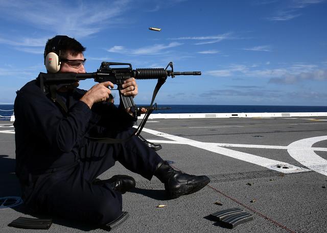 PACIFIC OCEAN - Logistics Specialist 1st Class Kevin Nycum fires an M16 service rifle during a gun shoot aboard amphibious transport dock ship USS Green Bay (LPD 20).