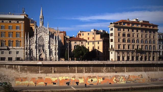 Chiesa del Sacro Cuore di Gesù in Prati and graffiti at the river