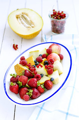 cut fruits: melon, strawberry, raspberry, peaches…