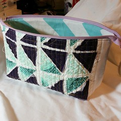 Found this scrap of scrap quilting in a box where I was looking for something else. Made a open wide pouch. Pretty sure these triangles are leftover from piecing binding! Raw edge quilted down. Now what was I supposed to be doing?