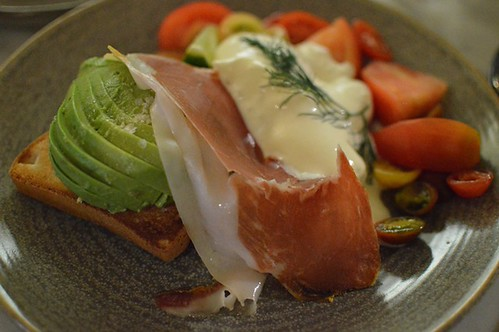 Heirloom tomatoes with two soft poached eggs, jamon, fresh avocado on GF toast w a smoked cheese sauce
