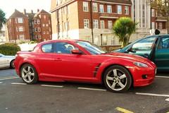 automobile(1.0), automotive exterior(1.0), wheel(1.0), vehicle(1.0), automotive design(1.0), mazda(1.0), rim(1.0), bumper(1.0), land vehicle(1.0), luxury vehicle(1.0), mazda rx-8(1.0), supercar(1.0), sports car(1.0),