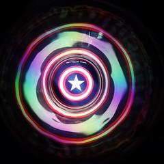 spiral(0.0), universe(0.0), compact disc(0.0), vortex(0.0), toy(0.0), symmetry(1.0), fractal art(1.0), purple(1.0), sphere(1.0), space(1.0), light(1.0), circle(1.0), blue(1.0),