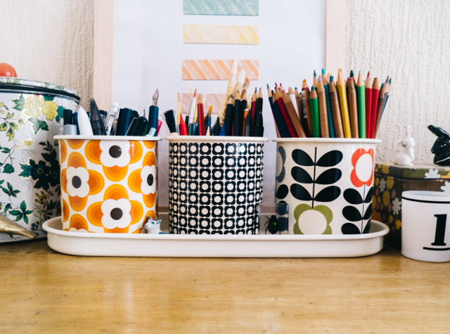 orla kiely plant pots with pens and pencils in