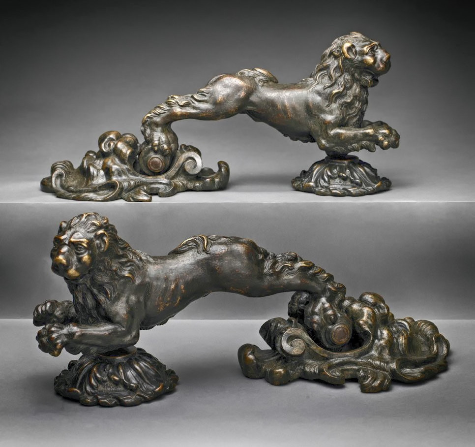 Early 1600s Bronze door knockers from Northern Italy featuring leaping lions and leonine mask backplates. metmuseum