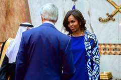 U.S. Secretary of State John Kerry greets First Lady Michelle Obama after greeting the new King Salman of Saudi Arabia at the Erqa Royal Palace in Riyadh, Saudi Arabia, on January 27, 2015, and after joining President Obama, the First Lady, and other dignitaries in extending condolences to the late King Abdullah. [State Department photo/ Public Domain]