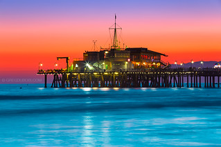Sunset Burn over Santa Monica Pier and Pacific Ocean with Malibu Mountains - Santa Monica Beach Los Angeles County California