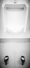 room(0.0), bathtub(0.0), tap(0.0), circle(0.0), bidet(0.0), sink(0.0), floor(1.0), toilet(1.0), white(1.0), line(1.0), monochrome photography(1.0), urinal(1.0), plumbing fixture(1.0), monochrome(1.0), bathroom(1.0), black-and-white(1.0), black(1.0),