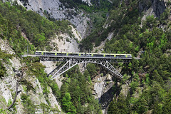 suspension bridge(0.0), rope bridge(0.0), mountain pass(0.0), track(0.0), viaduct(0.0), devil's bridge(1.0), mountain(1.0), transport(1.0), rolling stock(1.0), ravine(1.0), bridge(1.0),