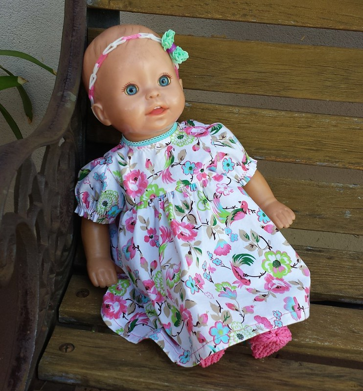 Burda doll dress sewn by Clare with loom band shoes and headband