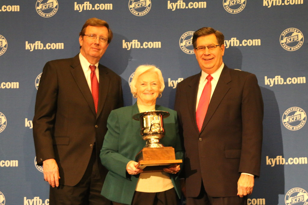 Betty Farris, President of Butler County Farm Bureau (center), accepts
