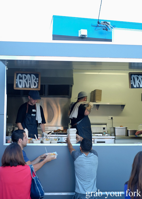 Picking up orders at the Mister Gee Burger Truck, Burwood Deluxe Car Wash