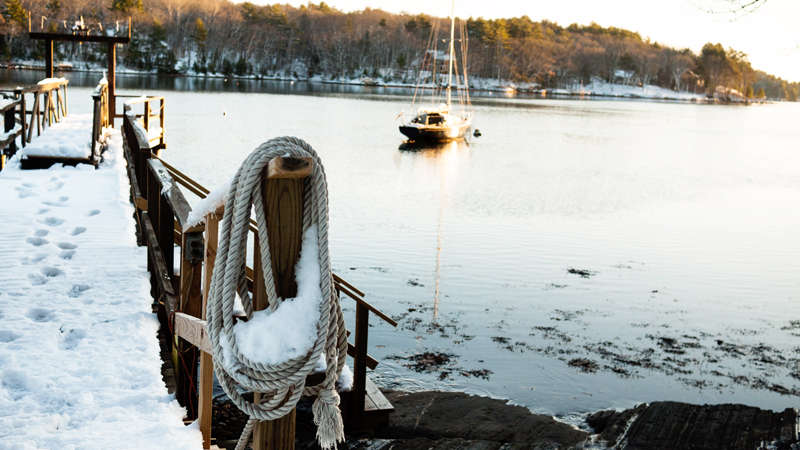 Snowy Maine Dock and Sailboat