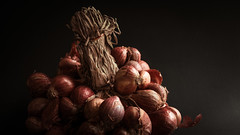 Sheaf of Red Onions. Retro and natural concept.