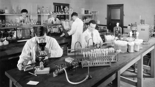 Students examining soil organisms in Soil laboratory ca. 1933
