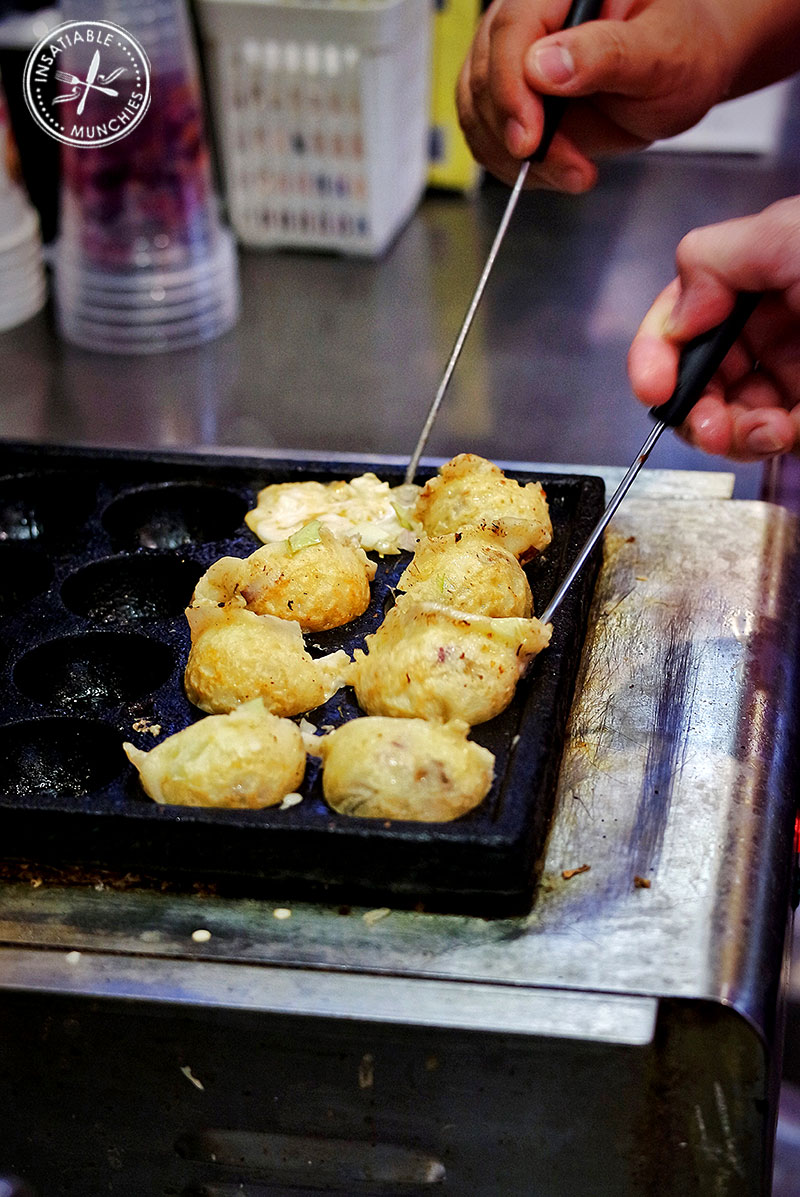 Takoyaki being flipped