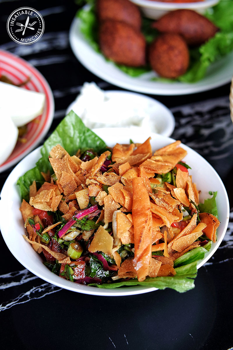 Fattoush: Salad of tomato, capsicum, onion, cabbage, mint, and parsley, dressed in lemon juice and olive oil.