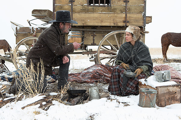 Tommy Lee Jones and Hilary Swank are pioneers under duress in THE HOMESMAN.