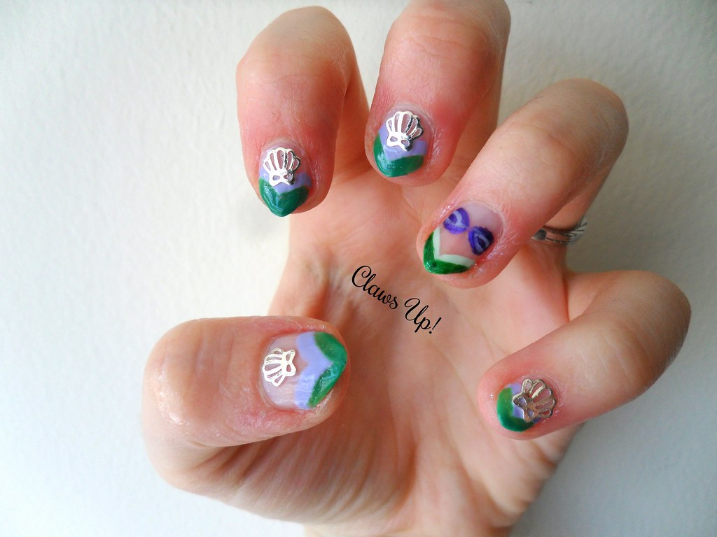 Little mermaid Ariel nail art with color change nail polish, french tips and seashell nail studs from Born Pretty Store