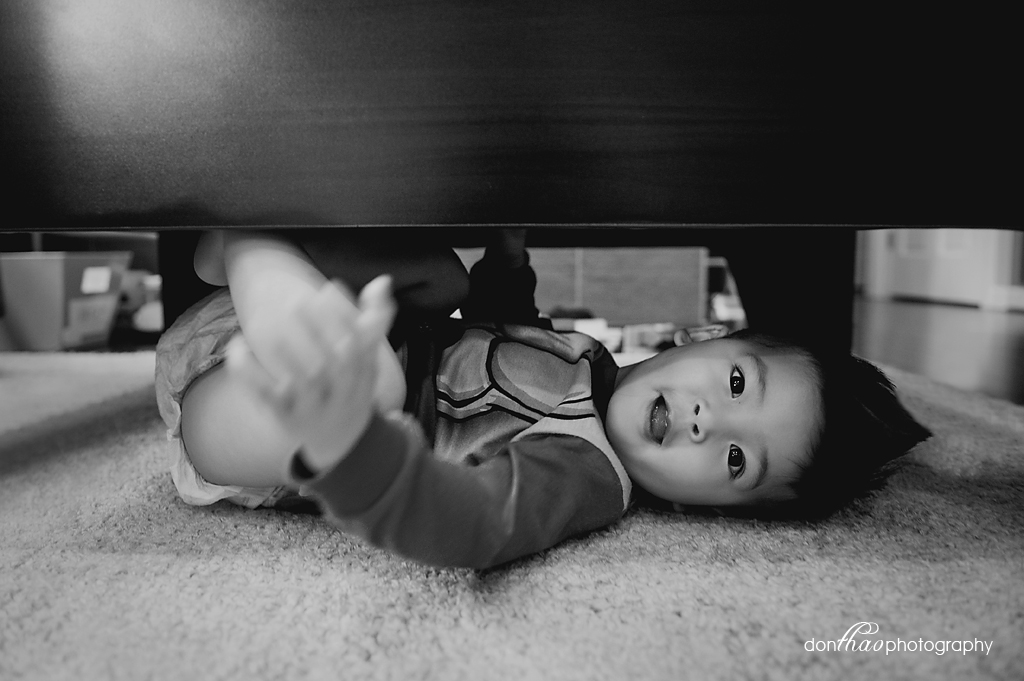 personal 365 - toddler hiding under train table photography