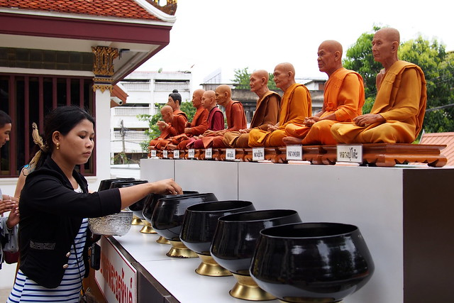 begging bowls and monk effigies, Bangkok, Thailand
