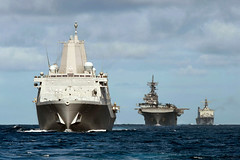 In this file photo, USS Anchorage (LPD 23), USS Essex (LHD 2) and USS Rushmore (LSD 47) steam in formation earlier this year. (U.S. Navy/MC2 Christopher B. Janik)