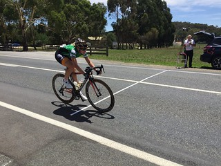 Nettie Edmondson crossing the sprint line to help retain the Green sprint jersey