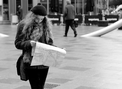 street uk urban bw woman white black girl monochrome hat wales scarf hair photography prime mono map candid cymru cardiff streetphotography olympus caerdydd f18 unposed 45mm omd m43 mft primelens em5 mzuiko justard justardcom