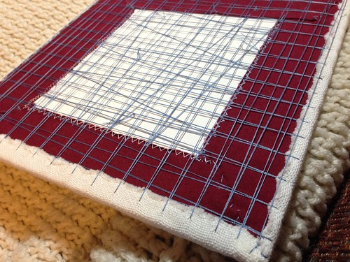 Hardanger and lining fabric mounted by lacing.