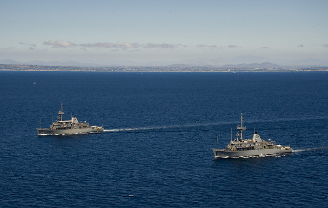 PACIFIC OCEAN - The Avenger-class mine countermeasures ships USS Scout (MCM 8) and USS Champion (MCM 4) transit in formation off the coast of Southern California as part of Rim of the Pacific (RIMPAC) Exercise 2014.