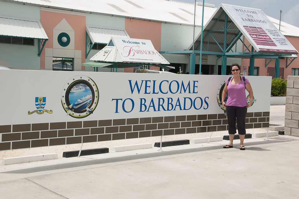 Me standing at Welcome to Barbados sign