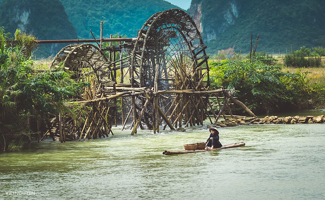 Unidentified farmers work at the bamboo raft in Caobang