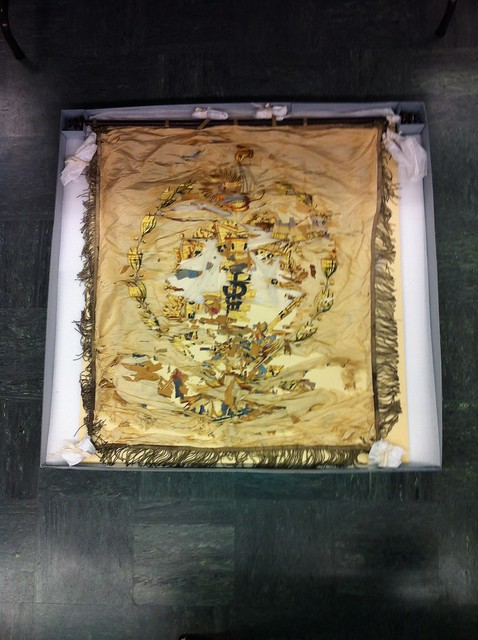 Philomathesian banner in archival box for safe storage