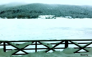 Watching completely frozen LAKE ABANT from Rest - Cafe terrace on chilly cold weather.