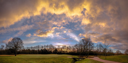 sun clouds and a golf course
