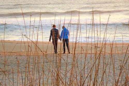 ocean beach sunrise dawn couple florida rushes handinhand indialantic