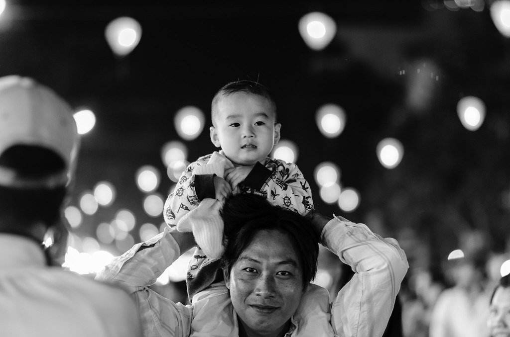 Father and son. Cantho city, Vietnam. January 27, 2014