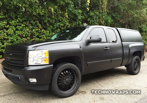 Satin black vinyl vehicle wrap by TechnoSigns