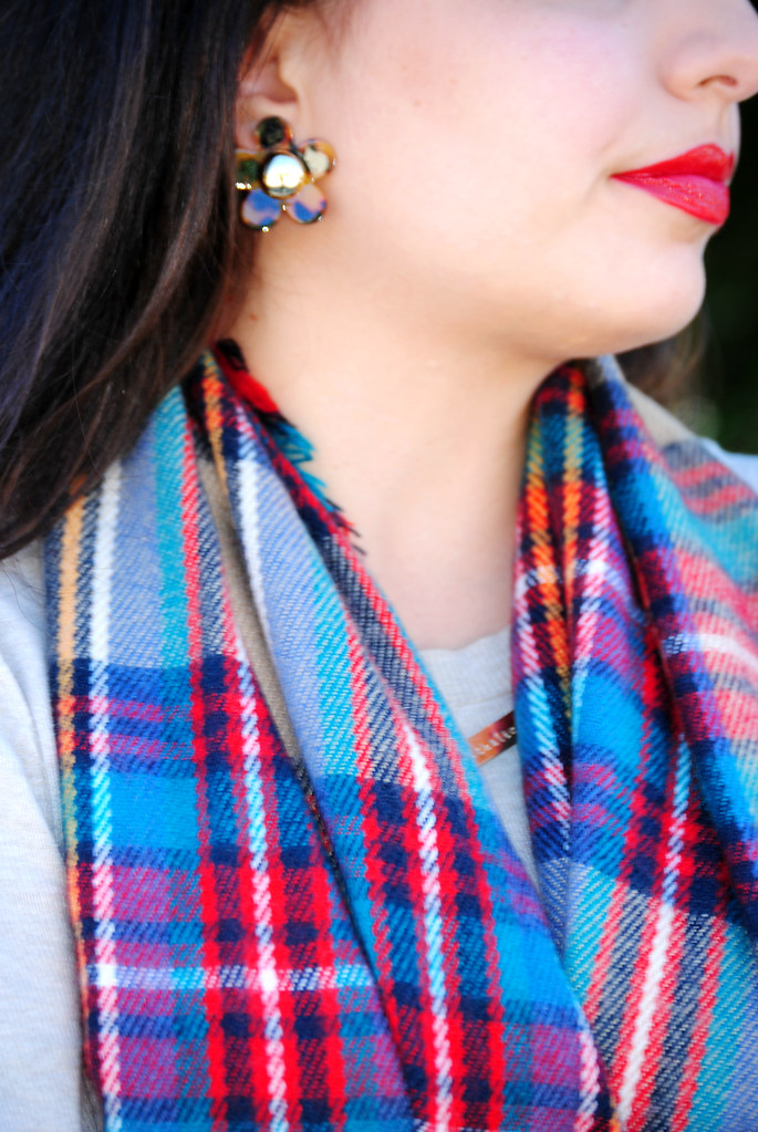 flower earrings, plaid scarf, red lip