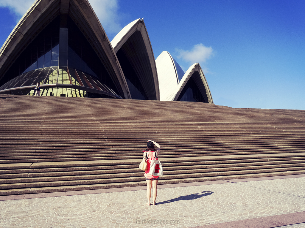 Photographer girl aka me standing alone in front of the steps of the Opera House in Sydney