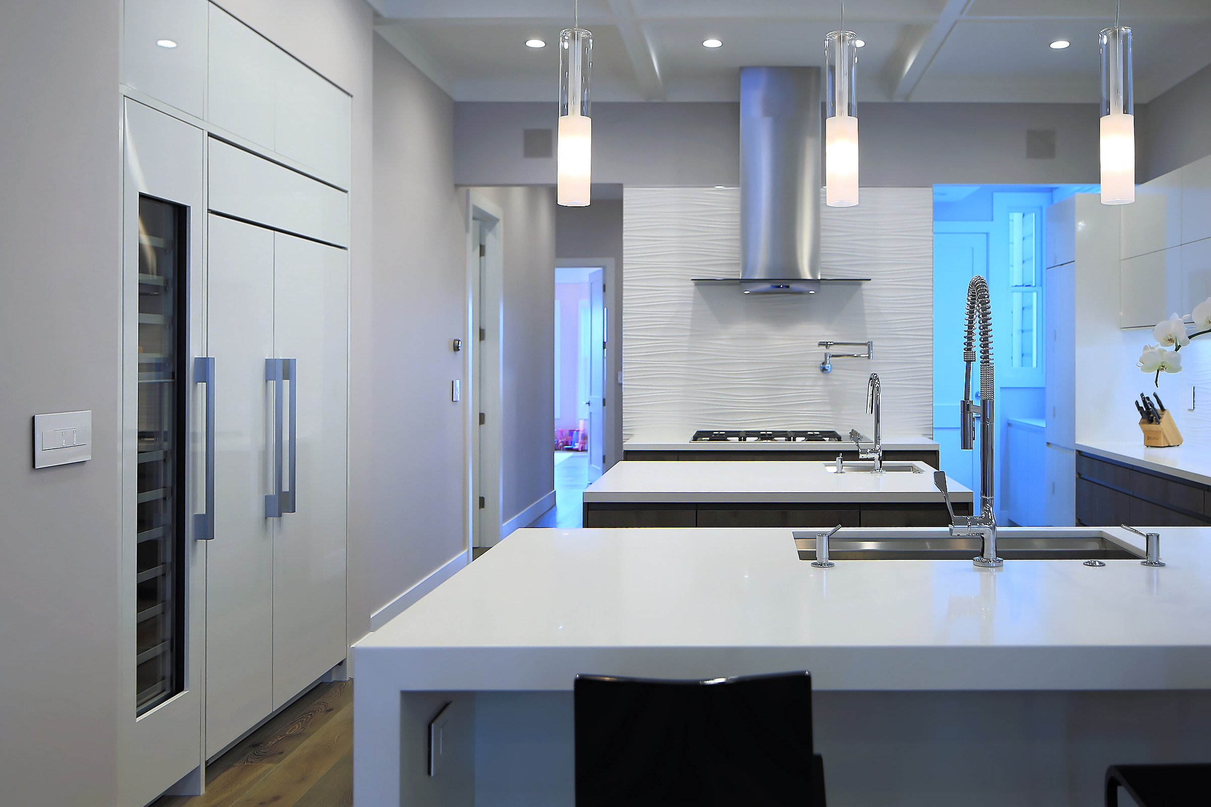 With two sinks and a cooking area, multiple people can work freely within this multiple island kitchen.
