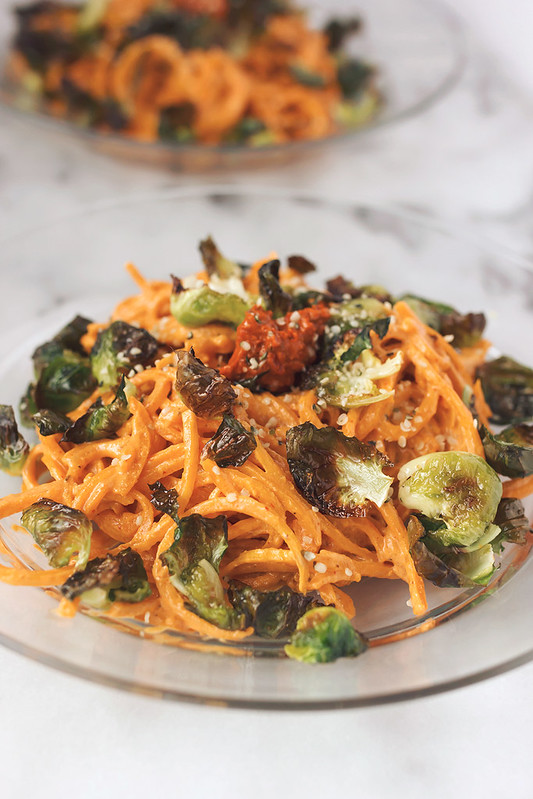 Butternut Squash Noodles with Harissa Cashew Cream and Crispy Brussels Sprout Chips // @tastyyummies // www.tasty-yummies.com