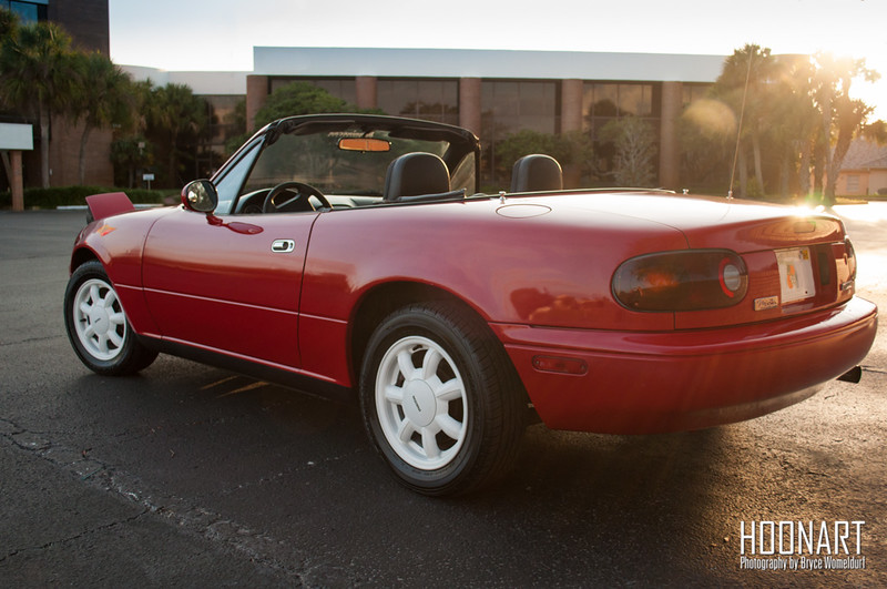 Rear of Miata at golden hour.