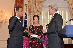 U.S. Secretary of State John Kerry swears in Rich Verma as the new U.S. Ambassador to India, at the U.S. Department of State in Washington, D.C., on December 19, 2014. [State Department photo/ Public Domain]