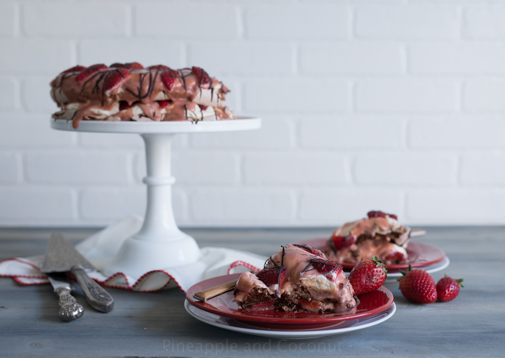 Chocolate Strawberry Pavlova. An impressive yet easy to make dessert for Valentine's Day. www.pineappleandcoconut.com